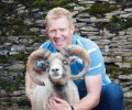 Adam Henson with a North Ronaldsay ram